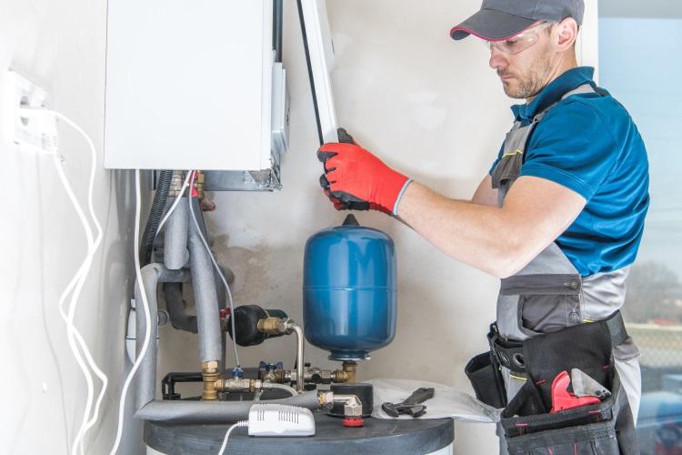 Engineer installing combi boiler