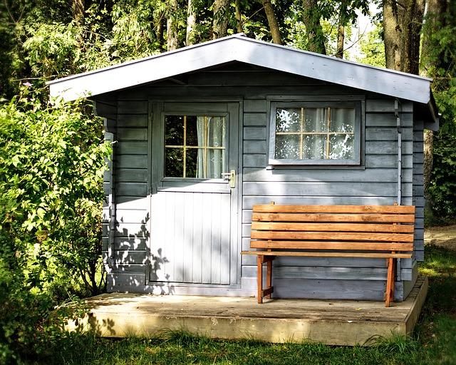 Grey garden shed in garden