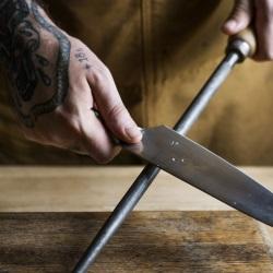 Man sharpening knife