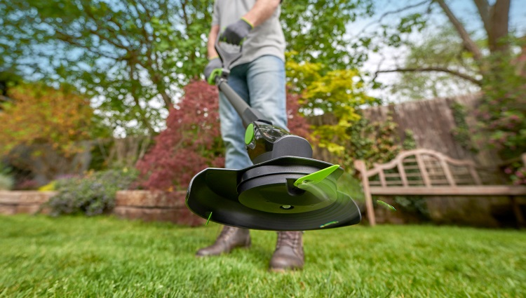 Man using GTech Grass Trimmer in Garden