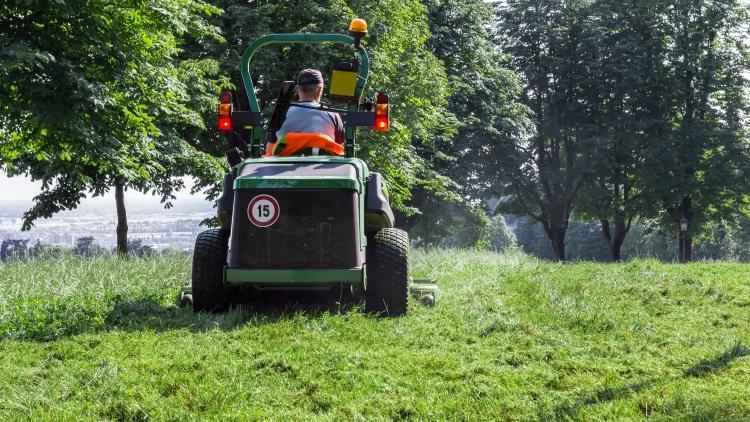 Man using ride on lawn mower