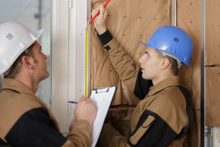 Men measuring for new building