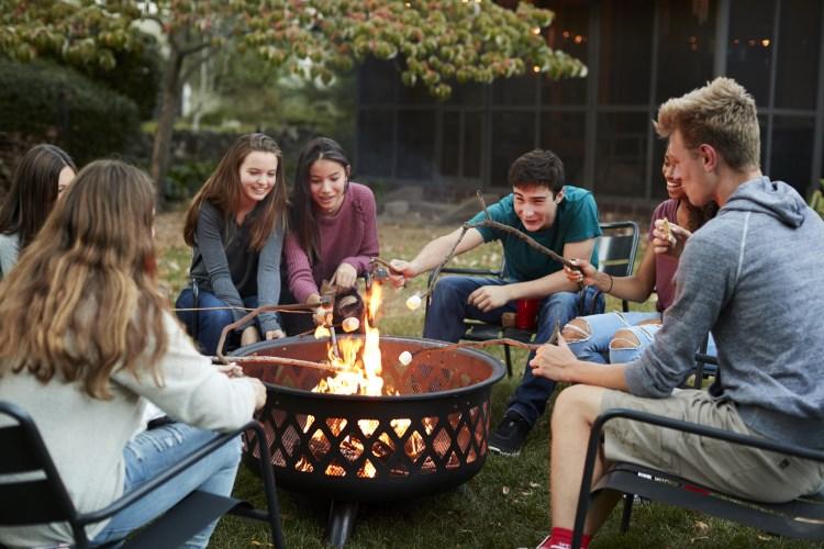 Friends around fire pit