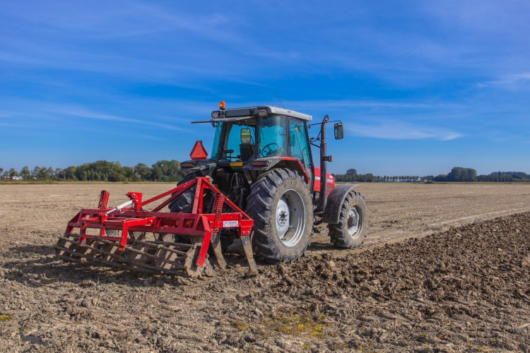 Tractor Farming the Land