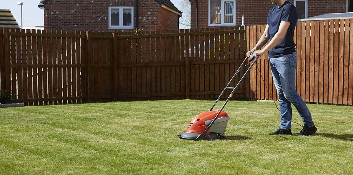 Flymo Hover Vac 250 Man cutting Grass