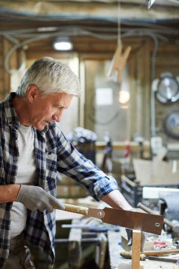 man Working with hand saw and wood
