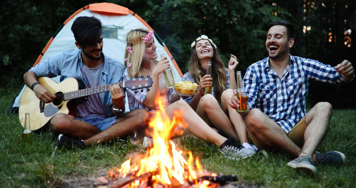 Friends camping in garden