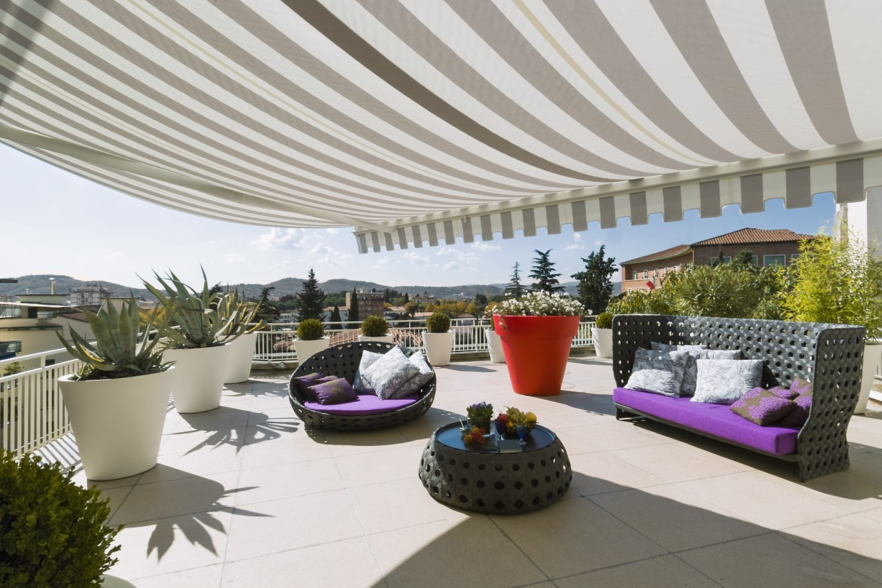 Large luxurious awning parasol on patio