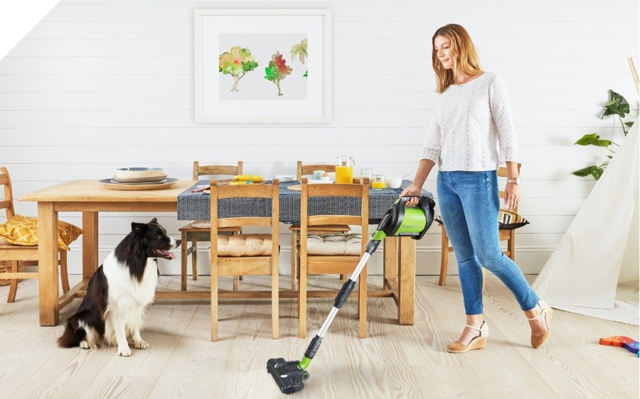 Woman using GTech Pro 2 at home