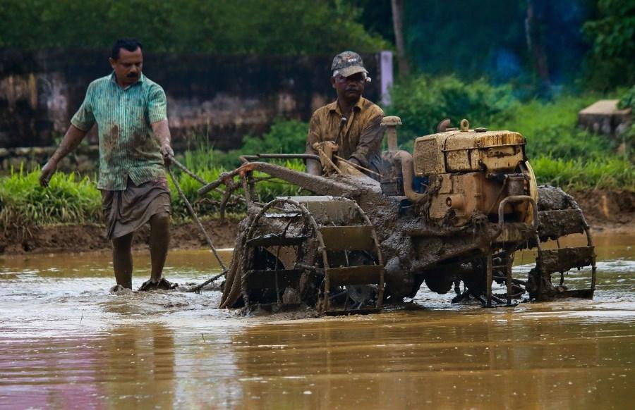 Indian Farmers Using Tiller