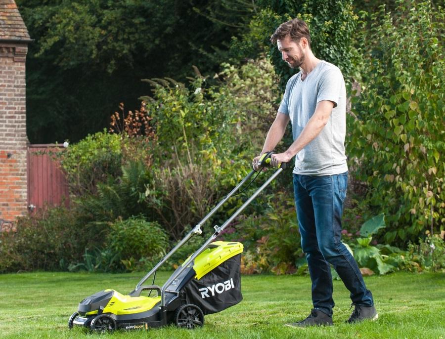 Man using lawnmower in garden
