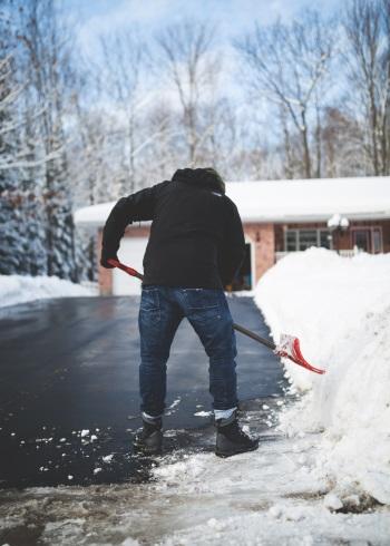 Man using shovel in snow