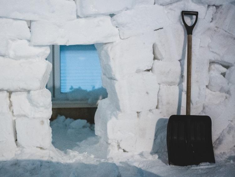 Shovel sitting outside igloo
