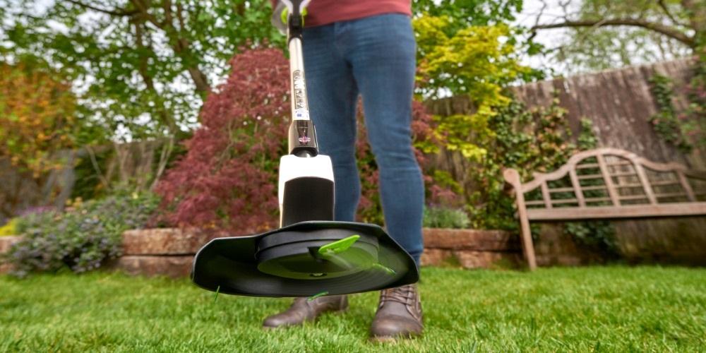 G Tech GT5 Grass Trimmer being used in garden