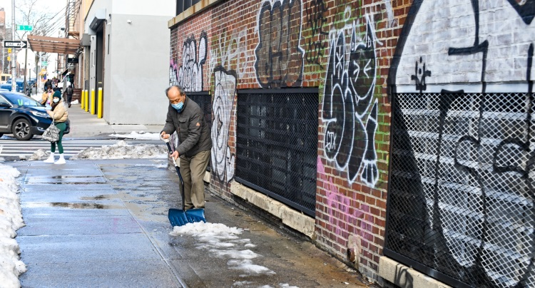 Man Shovelling Snow After it Settled