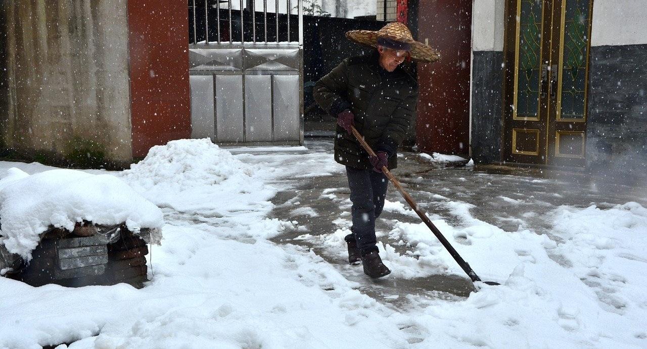 Man shovelling snow in winter