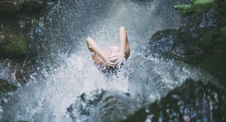 Woman showering in garden
